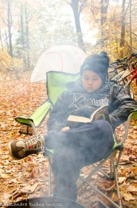 child reading by the campfire