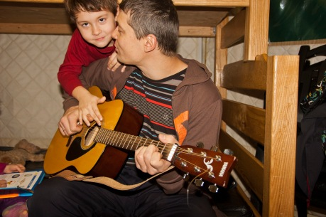 playing the guitar inside a yurt at MacGregor Point