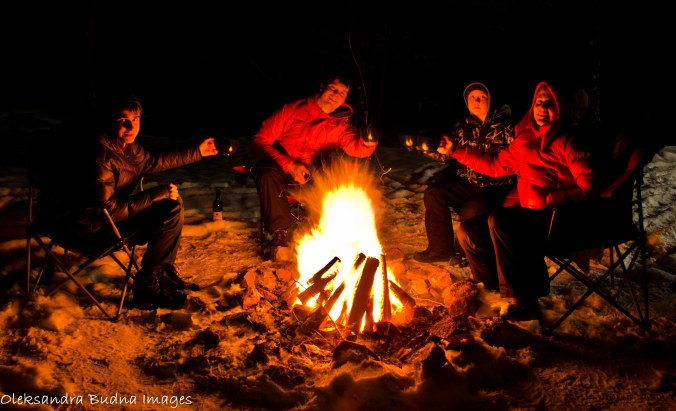 around a campfire in the winter