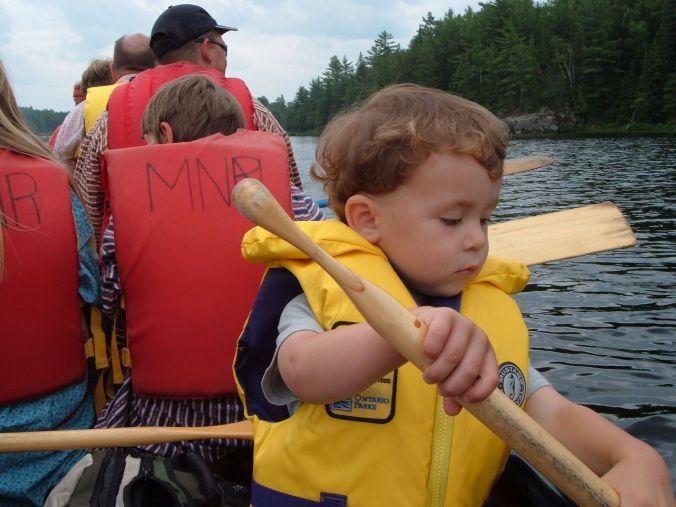 child paddling