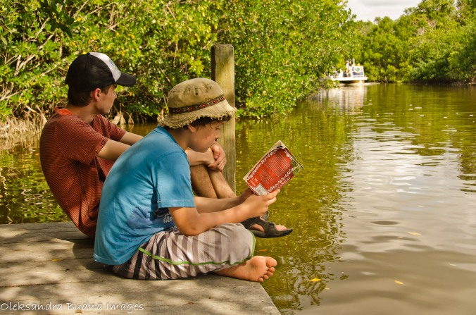 reading a book on the dock