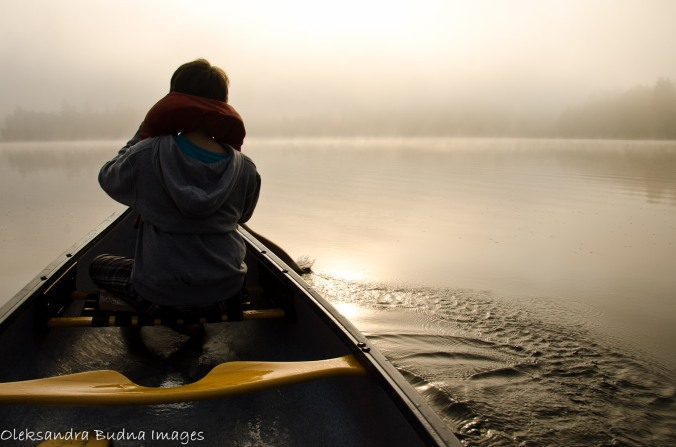 canoeing on a foggy lake
