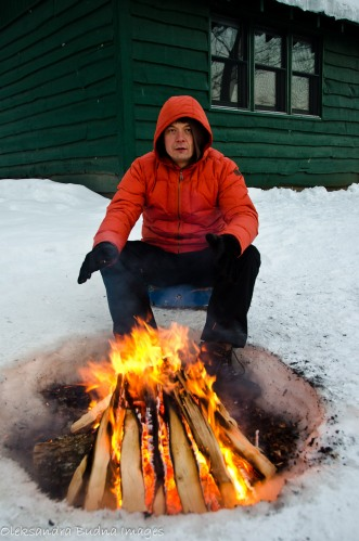man by the fire in the winter