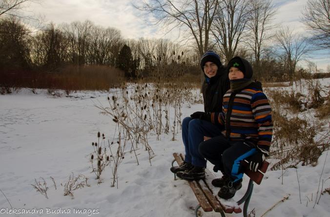 kids by a frozen river