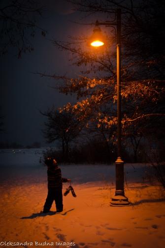 kid under a lantern at night