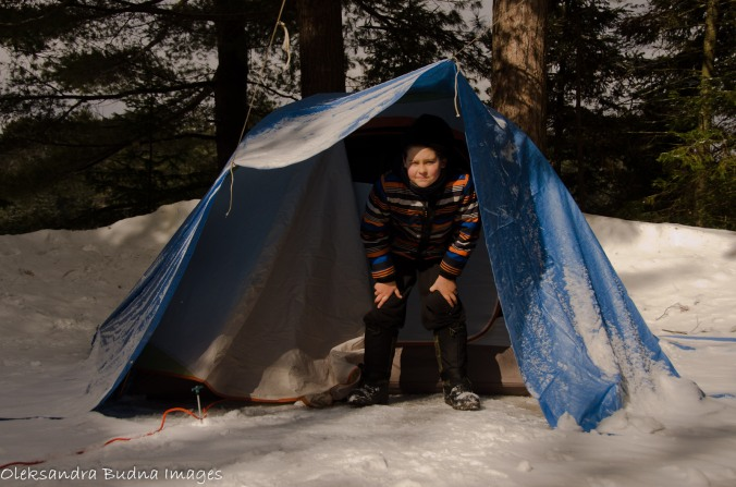 kid in front of the tent in winter