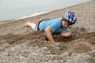 digging at the beach at Point Pelee National Park