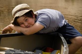 kid on a canoe
