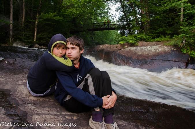 kids near the waterfall