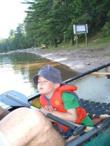 kid sleeping in a canoe