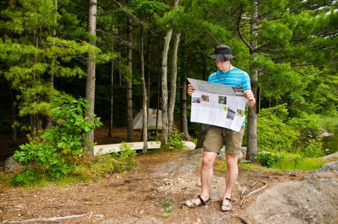 looking at a map at Masassauga Provincial Park