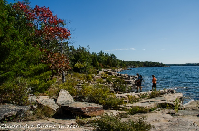 hiking along the rocky shoreline at Killbear Provincial Park