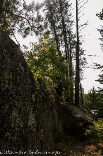 climbing up rocks in Quetico