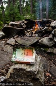 book and campfire in Quetico