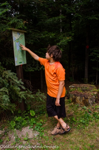 looking at a trail map at Quetico Provincial Park
