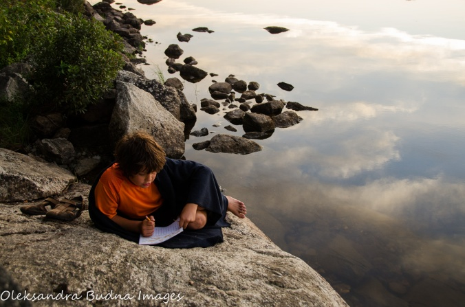 reading by the lake at Quetico Provincial Park