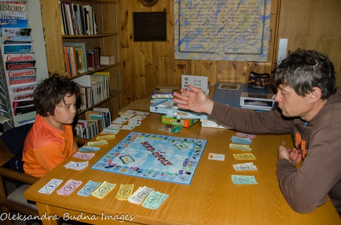 playing a board game at at John B. Ridley Research Library at Quetico Provincial Park