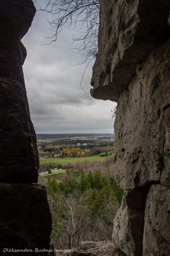 view of Lowville Valley through limestone cliffs at Rattlesnake Point