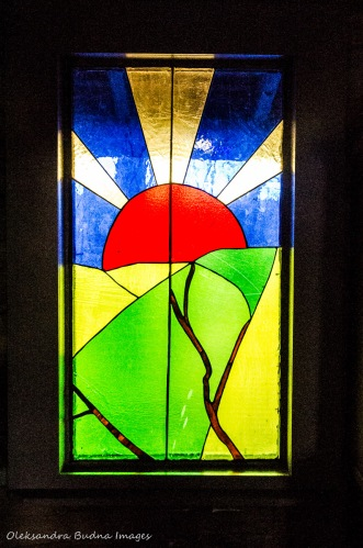 stained glass at Settler's Cabin at Elliott Tree Farm