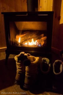 boots in front of a gas fireplace in a cabin in Killarney