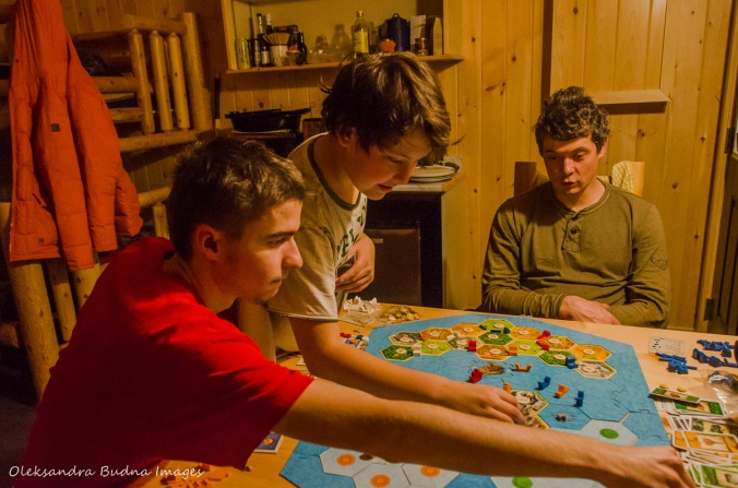 playing Settlers of Catan in a cabin in Killarney