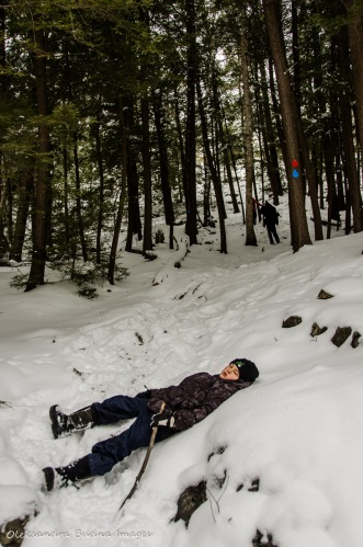 taking a rest during a hike to the Crack in Killarney in the winter