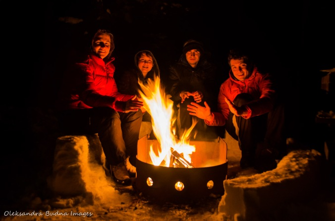 around a campfire in Killarney in the winter