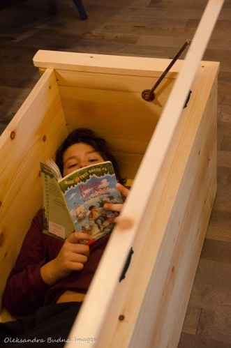 reading inside a storoage box in a camp cabin in Killarney