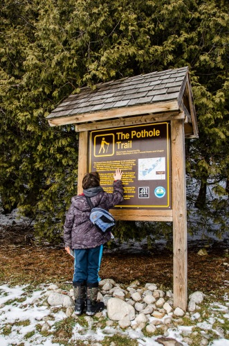 reading the Pothole Trail info panel at Rockwood Conservation Area