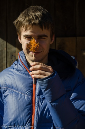 youth holding a maple syrop lollypop