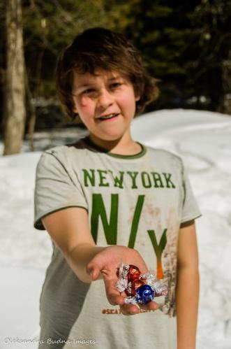 kid with chocolates