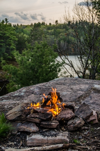 campfire with a view of Sheldon Lake at Queen Elizabeth II Wildlands