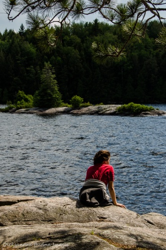 sitting on a rock near Silent Lake