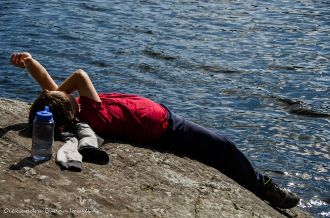 lying on the rock by the lak