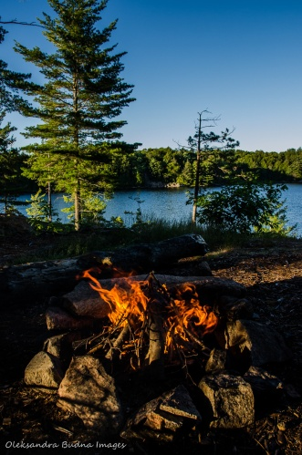 view of campfire and Terry Lake at site 56 in Killarney