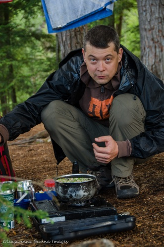 cooking a camping meal