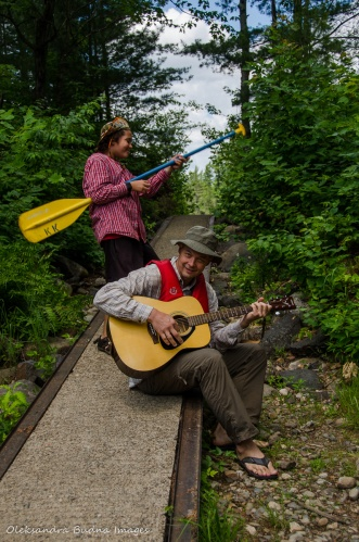playing the guitar on old marine railway on portage from Balsam to Three-mile lake