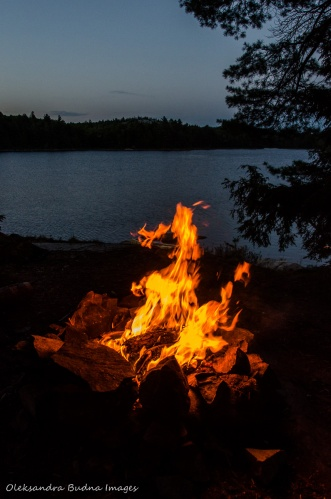 campfire with the view of Boundary Lake in Killarney