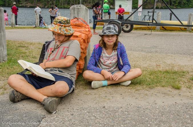 kids near a bag of firewood
