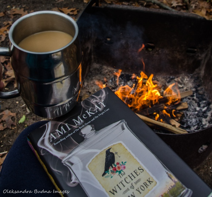 Book Witches of New York, cup of coffee and campfire