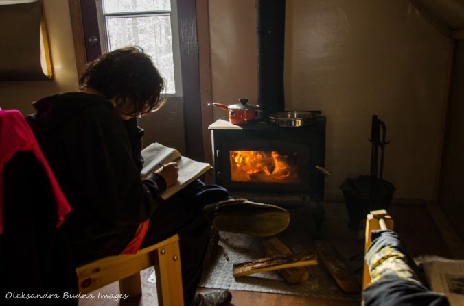 in front of a wood stove at four-seasons tent in Gatineau Park