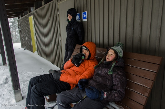 taking a break near a comfort station in Gatineau Park in the winter