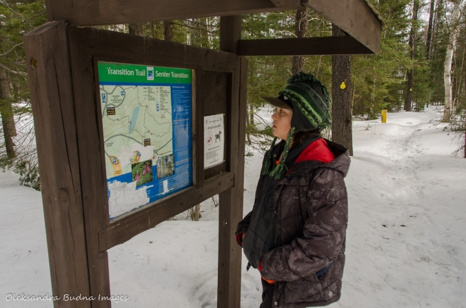 looking at the map of Transition Trail at Windy Lake in the winter