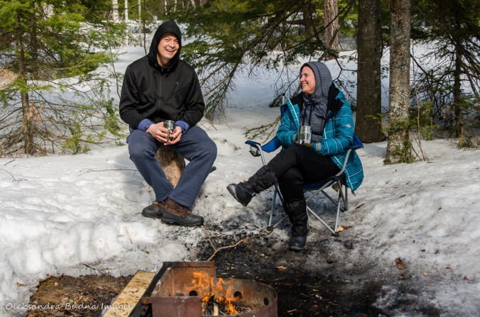 sitting near the campfire in the winter