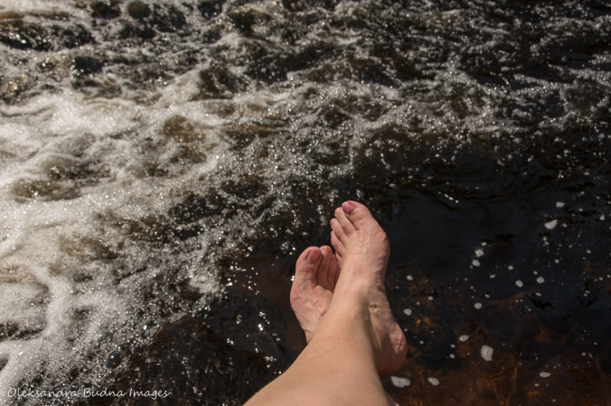 cooling my feet in Madawaska River falls in Algonquin