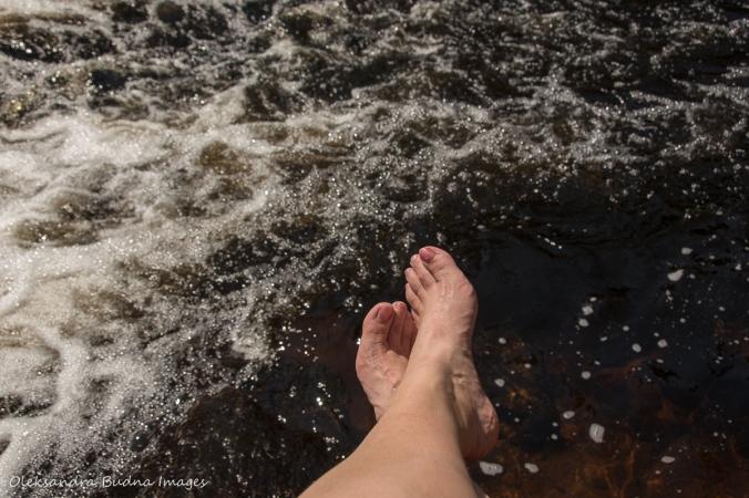 cooling my feet in Madawaska River falls in Algonquin