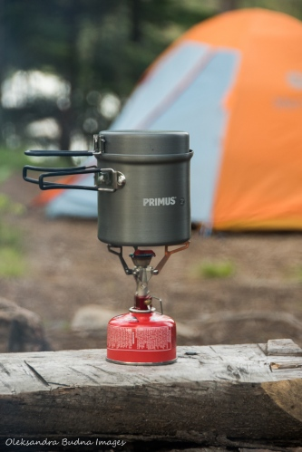 camping stove with a tent in the background