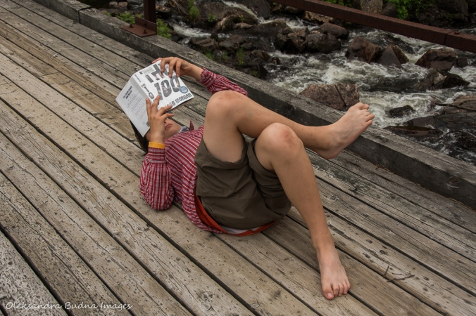reading a book during a portage at Point Grondine park