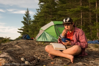 reading at a campsite