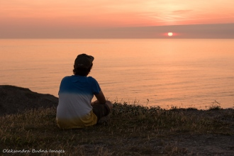 watching sunset at Salmon Point in Rocky Harbour Newfoundland
